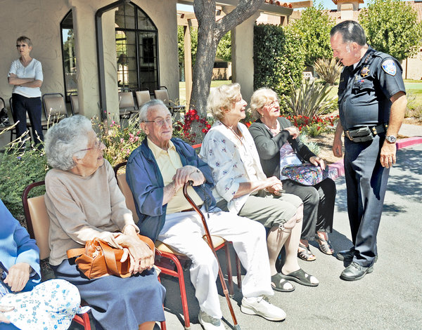 Residents of Oak Tree Villa raised money for the families of two fallen Santa Cruz police officers. Photo courtesy of Press-Banner.