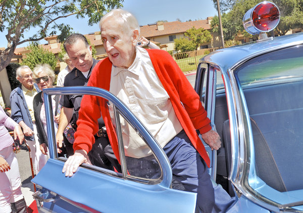 An Oak Tree Villa resident takes a ride in the Santa Cruz Police Department's 1961 Chevrolet Biscane cruiser. Photo Credit: Press-Banner, 2013.