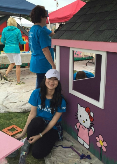 An MBK team member helps construct a playhouse for Habitat for Humanity.