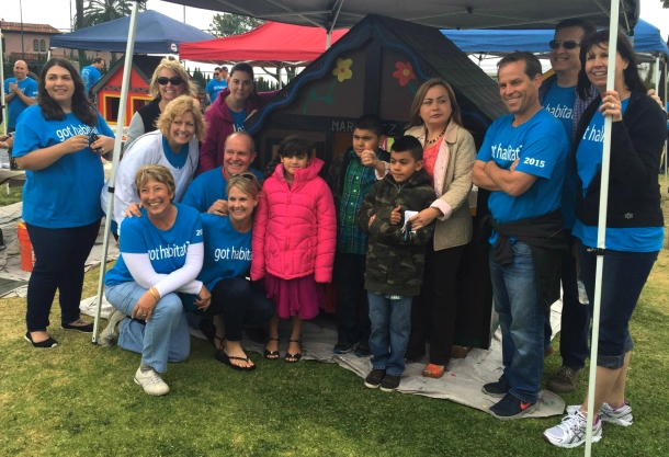 """The MBK team and their """"good work"""": playhouses constructed for Habitat for Humanity."""