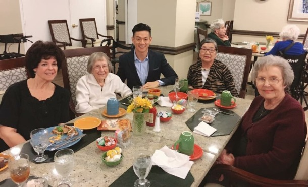 Assemblymember Evan Low (center) enjoying lunch and conversation with residents of Belmont Village San Jose. Image Credit: Belmont Village